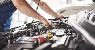 What is the difference between a car service and a MOT?